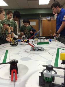 Weapons of Math Instruction discuss their robot with the judges.